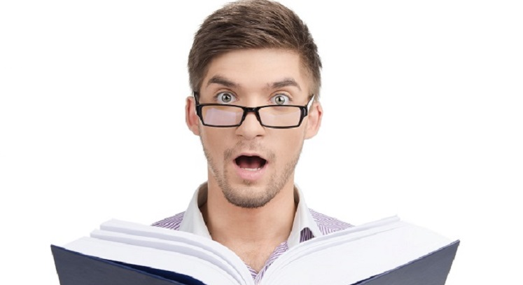 Young man in glasses with book